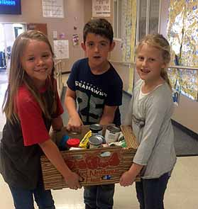 SIS students in food drive