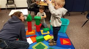 students and families building a tower