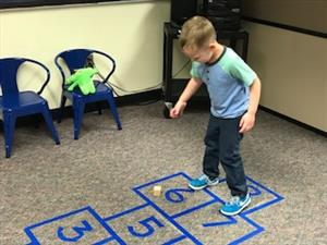 student playing hopscotch