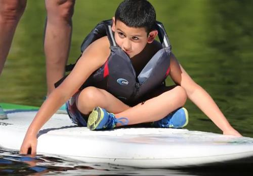 Octavio enjoys a recreational activity during summer camp.