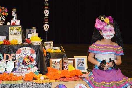 A Selah student displays her ofrenda during the Day of the Dead celebration.