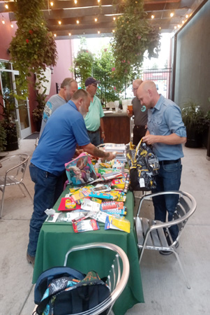 Thank you to Brian Rafferty from Edward Jones and his volunteer team as they stuff backpacks for students for the new year.